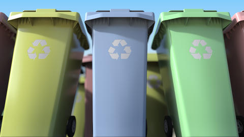 Many plastic trash cans with for sorting domestic garbage. Loopable motion Footage