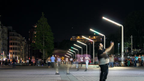 People walking on city square at night - Time lapse video - Istanbul Taksim Square Live Action