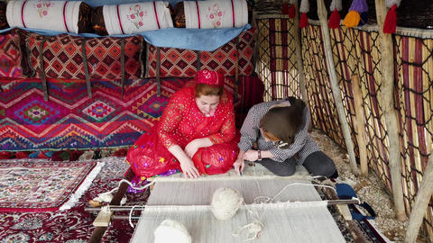 Shiraz, Iran - 2019-04-09 - Older Qashqai Woman Teaches Younger Woman How to Footage