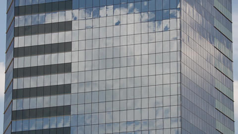 The clouds reflected in glass skyscraper Footage