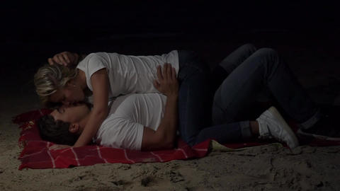 Slow Motion An Attractive Couple Kissing On The Beach Footage