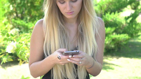 Real Time Young Girl Texting Outdoors On Phone Footage