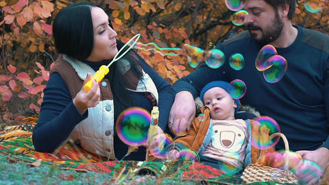 Slow Motion Family Playing With Soap Bubbles Footage
