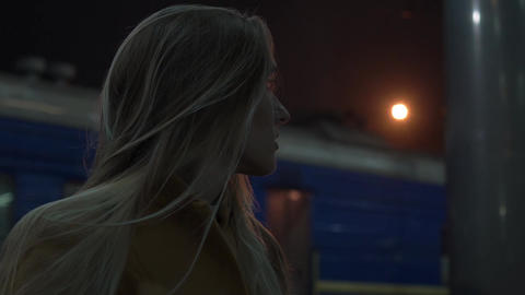 Real Time Young Attractive Blonde Woman Waits At A Railway Station Footage