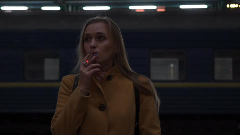 Real Time Girl Lighting Cigarette At Railway Station Footage