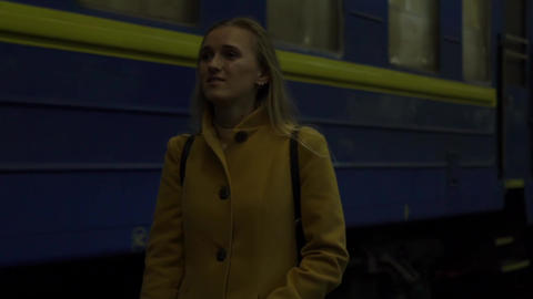 Slow Motion Young Woman Walk Peaceful Inside Railway Station: Searching, Waiting Live Action