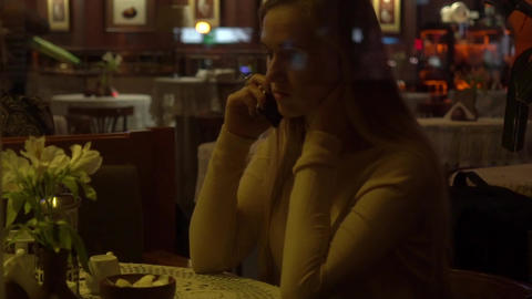 Slow Motion Young, Happy Woman Talking On Cellphone In Cafe In The Evening Live Action