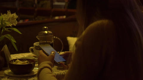 Real Time Beautiful Woman Text Messaging On Your Phone In A Cafe With A Cup Of Footage