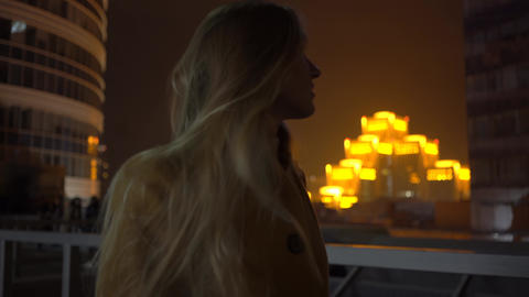4K Portrait Of Beautiful Blonde Woman By The Street At Night Footage
