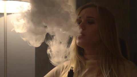 Slow Motion Woman Smoke Vaporizer Or Electronic Cigarette Live Action