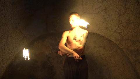 Fire Show Performance. Male Fire Performer Spinning Burning Fire Rope Dart Poi Live Action