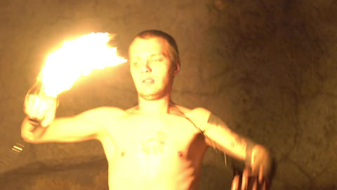 Slow Motion Male Fire Show Performer At Night. Poi Performance Live Action