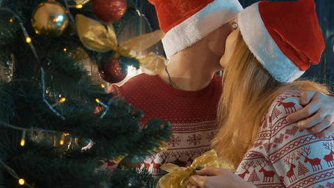Real Time Slow Motion Young Couple In Love, Putting Toys On A Christmas Tree Footage