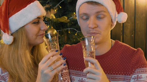 Real Time Couple In Love Clinking Glasses With Champagne At Christmas Event Live Action