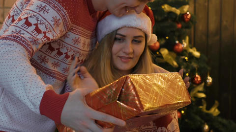 Real Time Real Time Man Presenting A Surprise Gift Box To A Woman Footage