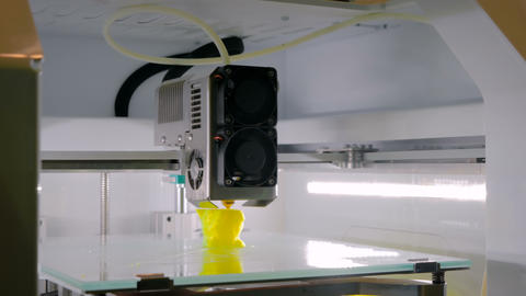 Automatic three dimensional 3D printer machine working at technology exhibition Footage