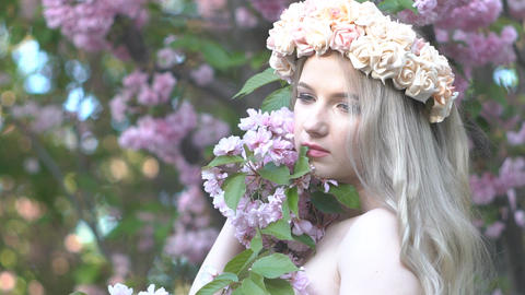 Portrait Of A Young Caucasian Woman Standing In A Blooming Cherry Footage