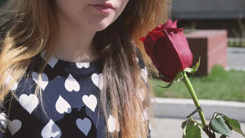 Beautiful girl holding a rose close-up video footage Footage