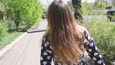 Beautiful girl walking in the Park Footage