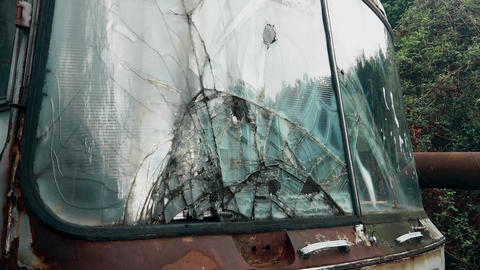 A broken windshield on an old and abandoned truck Footage