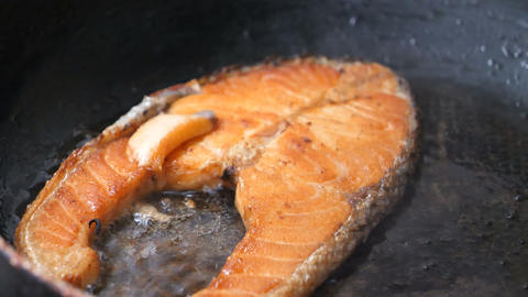 Close-up shot cooking and grill salmon steak in the hot pan the food for good health Live Action