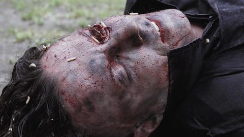 Scary corpse with decaying eye with maggots in it Live Action