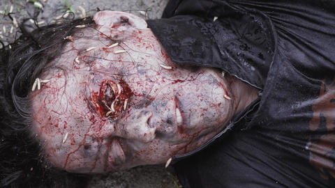 Close up of a man dead on the ground with decaying eye Live Action
