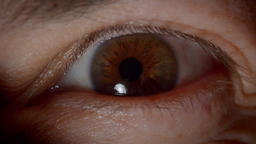 Close-up shoot of caucasian person with brown eyes blinking and watching Footage