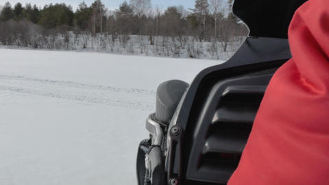 snowmobile driver makes sharp turn on snow valley surface Footage