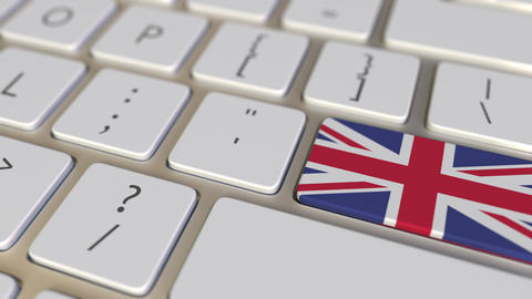 Key with flag of Great Britain on the computer keyboard switches to key with Footage