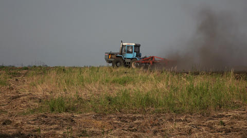 Tractor Plowing A Field In Contry Side stock footage