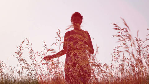 woman running on the field towards the camera Footage