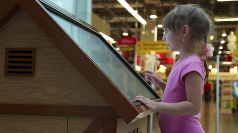 The girl works with a large tablet touchscreen Live Action