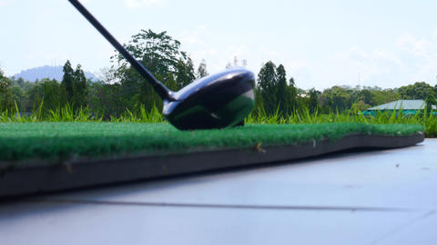 Golf ball behind driver at driving range Footage