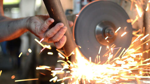Closed Up Grinding Stone With Sparks Live Action