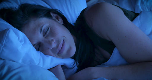 Close up of an attractive woman smiling while sleeping at... Stock Video Footage