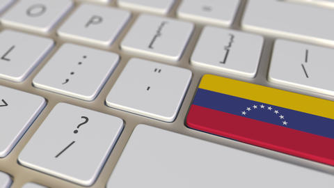 Key with flag of Venezuela on the computer keyboard switches to key with flag of Footage