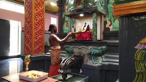 Nuware, Sri Lanka - 2019-03-26 - Hindu Priest Gives Offering to God Statue Live Action