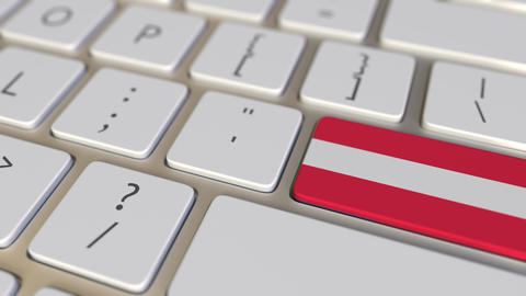 Key with flag of Austria on the computer keyboard switches to key with flag of Footage