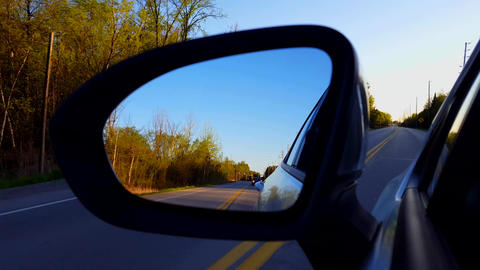 Driving Rural Road View of Side Mirror in Daytime. Driver Point of View POV Looking Down Side View Footage