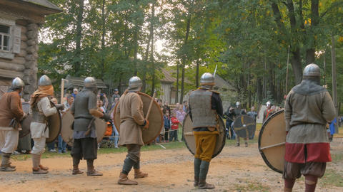 Militant medieval warriors fighting at historical festival Footage