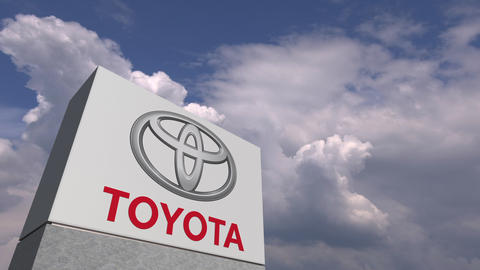 TOYOTA logo against sky background, editorial animation Live Action