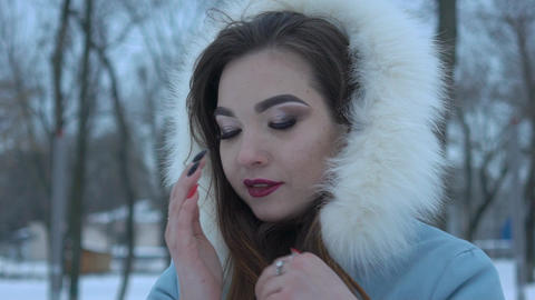 Young Beautiful Woman Posing Over Winter Forest. Outdoor Winter Portrait Over Live Action