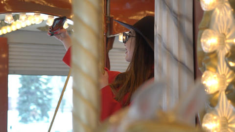 Close Up Of Beautiful Happy Woman Having Fun Riding Carousel In Amusement Footage