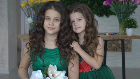 Two Young Beautiful Sisters Into Studio Room, Posing For Photos Footage