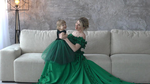 Mother-Child Relationship, Mom And Daughter In Identical Dresses In Studio Footage
