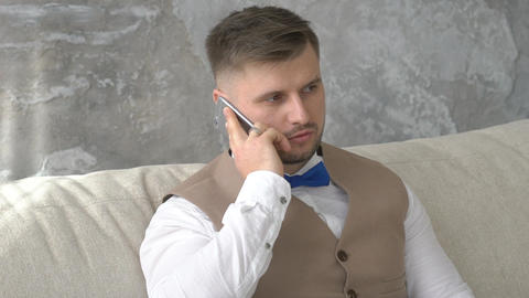 Handsome Man Is Talking On Mobile Phone ビデオ
