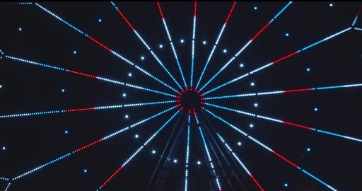 Slow revolving ferris wheel in evening illumination Footage