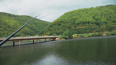Beautiful landscape The fishing rod stands on the stand Live Action