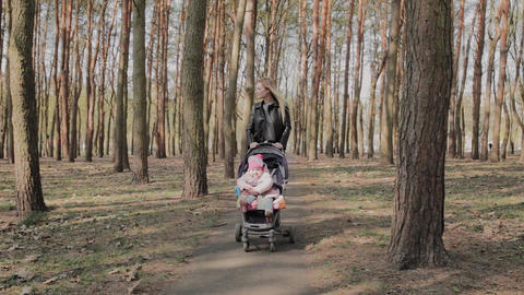 Beautiful woman walking with her little daughter and... Stock Video Footage